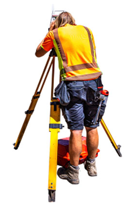 Surveyor with instrument in the filed.